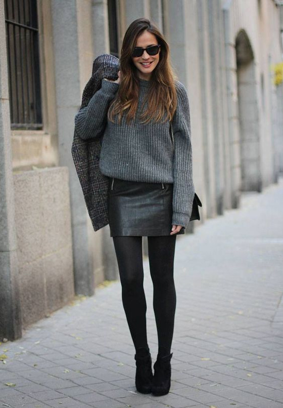 Black leather skirt and gray sweater
